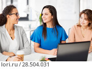 Купить «businesswomen with laptop working at office», фото № 28504031, снято 17 марта 2018 г. (c) Syda Productions / Фотобанк Лори