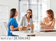 Купить «happy businesswomen eating take out food at office», фото № 28504043, снято 17 марта 2018 г. (c) Syda Productions / Фотобанк Лори