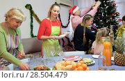 Купить «Family is preparing for celebration New Year together at home.», видеоролик № 28504479, снято 17 января 2018 г. (c) Яков Филимонов / Фотобанк Лори