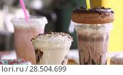 Milkshakes with donuts for takeaway in a cafe. Стоковое видео, видеограф Ekaterina Demidova / Фотобанк Лори