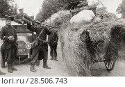 Купить «Soldiers looking for German spies search a haywagon using bayonets in Aarschot, Belgium during WWI. From The War Illustrated Album Deluxe, published 1915.», фото № 28506743, снято 17 января 2019 г. (c) age Fotostock / Фотобанк Лори