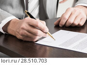 Купить «Business man signing a contract», фото № 28510703, снято 11 марта 2017 г. (c) Иван Михайлов / Фотобанк Лори