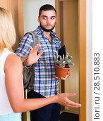 Купить «Young couple separating after quarrel», фото № 28510883, снято 27 марта 2019 г. (c) Яков Филимонов / Фотобанк Лори