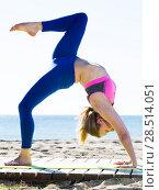 Купить «Woman practicing different yoga exercises», фото № 28514051, снято 6 мая 2017 г. (c) Яков Филимонов / Фотобанк Лори
