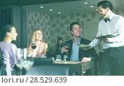 Купить «waiter bringing ordered dishes to guests», фото № 28529639, снято 8 января 2018 г. (c) Яков Филимонов / Фотобанк Лори