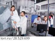 Купить «Adults trying to get out of escape room», фото № 28529699, снято 6 июля 2017 г. (c) Яков Филимонов / Фотобанк Лори