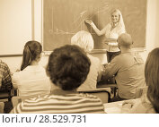 Купить «Adult students with teacher in classroom», фото № 28529731, снято 17 декабря 2018 г. (c) Яков Филимонов / Фотобанк Лори