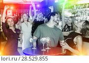 Купить «People celebrating birthday in bar», фото № 28529855, снято 2 августа 2017 г. (c) Яков Филимонов / Фотобанк Лори