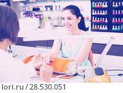 Купить «Manicure masters working», фото № 28530051, снято 28 апреля 2017 г. (c) Яков Филимонов / Фотобанк Лори