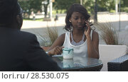 Купить «Confident afro american administrative manager of trading corporating working during work break waiting for telephone call from business partners to discuss details of collaboration in coffee shop», фото № 28530075, снято 20 октября 2019 г. (c) Vasily Alexandrovich Gronskiy / Фотобанк Лори
