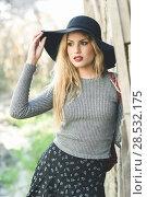 Купить «Beautiful young blonde woman, model of fashion, in rural background. Girl wearing sweater, skirt and hat.», фото № 28532175, снято 17 ноября 2015 г. (c) Ingram Publishing / Фотобанк Лори