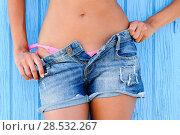 Close up of a woman in jeans texas shorts and pink bikini. Стоковое фото, фотограф Javier Sánchez Mingorance / Ingram Publishing / Фотобанк Лори