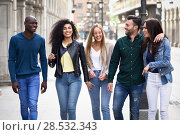 Купить «Multi-ethnic group of young people having fun together outdoors in urban background. group of people walking together», фото № 28532343, снято 23 апреля 2017 г. (c) Ingram Publishing / Фотобанк Лори