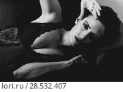 Купить «Beautiful woman in black lingerie laying on a couch», фото № 28532407, снято 28 ноября 2017 г. (c) Ingram Publishing / Фотобанк Лори