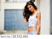 Купить «Portrait of a beautiful woman smiling in urban background», фото № 28532443, снято 20 мая 2012 г. (c) Ingram Publishing / Фотобанк Лори