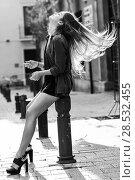 Купить «Portrait of blonde girl moving her amazing long hair», фото № 28532455, снято 15 ноября 2014 г. (c) Ingram Publishing / Фотобанк Лори