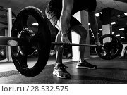 Closeup of weightlift workout at the gym with barbell. Man wearing sportswear clothes. Стоковое фото, фотограф Javier Sánchez Mingorance / Ingram Publishing / Фотобанк Лори