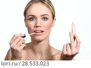 Купить «Beautiful woman with clean fresh skin applying pink lip gloss. Skin care face. Cosmetology. Blonde girl with blue eyes.», фото № 28533023, снято 22 января 2017 г. (c) Ingram Publishing / Фотобанк Лори