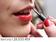 Купить «Part of attractive woman's face with fashion red lips makeup. Make-up artist apply bloody lipstick», фото № 28533459, снято 10 марта 2015 г. (c) Ingram Publishing / Фотобанк Лори