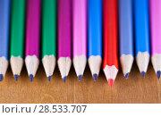 Купить «Black lead pencils lie in a row, one pencil has a red core and put forward , small depth of sharpness», фото № 28533707, снято 6 марта 2016 г. (c) Куликов Константин / Фотобанк Лори