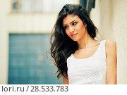 Купить «Portrait of a beautiful woman smiling in urban background», фото № 28533783, снято 20 мая 2012 г. (c) Ingram Publishing / Фотобанк Лори