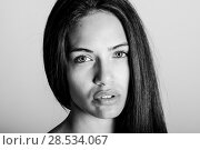 Купить «Beautiful young woman without make-up. Beautiful girl with green eyes, model of fashion wearing black tank top on white background.», фото № 28534067, снято 30 января 2016 г. (c) Ingram Publishing / Фотобанк Лори