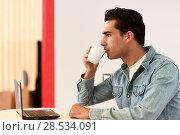 Купить «Good looking man wearing denim shirt sitting in a coffee bar. Blue eyes guy with casual clothes.», фото № 28534091, снято 17 ноября 2016 г. (c) Ingram Publishing / Фотобанк Лори