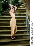 Купить «Portrait of a beautiful young woman, model of fashion, in a garden stairs», фото № 28534327, снято 20 мая 2012 г. (c) Ingram Publishing / Фотобанк Лори