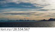 Купить «Sea with mountain range in the background, Norway», фото № 28534567, снято 27 мая 2019 г. (c) Ingram Publishing / Фотобанк Лори