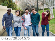 Купить «Group of multi-ethnic young people having fun together outdoors in urban background. group of people walking together», фото № 28534575, снято 22 марта 2015 г. (c) Ingram Publishing / Фотобанк Лори