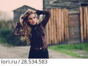 Купить «Portrait of blonde young woman playing with her curly hair in a rural road wearing shirt», фото № 28534583, снято 14 ноября 2015 г. (c) Ingram Publishing / Фотобанк Лори