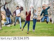 Купить «Group of multi-ethnic young people jumping together outdoors», фото № 28534975, снято 22 марта 2015 г. (c) Ingram Publishing / Фотобанк Лори