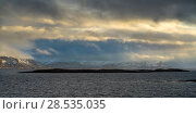 Scenic view of sea with mountain range in the background, Bodo, Nordland, Norway. Стоковое фото, фотограф Keith Levit / Ingram Publishing / Фотобанк Лори