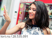 Купить «Portrait of attractive young woman trying on a ring at a jewelry», фото № 28535091, снято 20 мая 2012 г. (c) Ingram Publishing / Фотобанк Лори