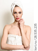 Купить «Beautiful blond woman with white towel on her head. Young girl with blue eyes and red lips.», фото № 28535235, снято 11 декабря 2016 г. (c) Ingram Publishing / Фотобанк Лори