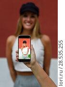Купить «Woman hand taking photograph with a smartphone to her friend», фото № 28535255, снято 20 сентября 2017 г. (c) Ingram Publishing / Фотобанк Лори