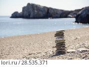 Купить «Pebbles in balancing on the sea coast», фото № 28535371, снято 22 февраля 2014 г. (c) Ingram Publishing / Фотобанк Лори