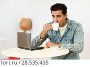 Купить «Good looking man wearing denim shirt sitting in a coffee bar. Blue eyes guy with casual clothes.», фото № 28535435, снято 17 ноября 2016 г. (c) Ingram Publishing / Фотобанк Лори