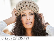 Купить «Portrait of a young black woman, afro hairstyle, in urban background, girl wearing wool cap», фото № 28535499, снято 11 декабря 2011 г. (c) Ingram Publishing / Фотобанк Лори