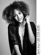 Купить «Young black woman with afro hairstyle laughing. Girl wearing black clothes. Studio shot. Black and white photograph», фото № 28535635, снято 14 июня 2016 г. (c) Ingram Publishing / Фотобанк Лори