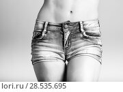 Купить «Beautiful woman body in denim jeans shorts on white background», фото № 28535695, снято 12 января 2016 г. (c) Ingram Publishing / Фотобанк Лори