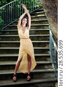 Купить «Portrait of a beautiful young woman, model of fashion, in a garden stairs», фото № 28535699, снято 20 мая 2012 г. (c) Ingram Publishing / Фотобанк Лори