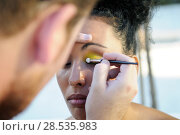 Купить «Professional makeup with a beautiful young black woman having touches applied to her make up by a beautician», фото № 28535983, снято 16 сентября 2012 г. (c) Ingram Publishing / Фотобанк Лори