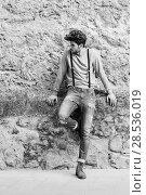Купить «Portrait of young man wearing suspenders and blue jeans in urban background with modern haircut», фото № 28536019, снято 8 апреля 2014 г. (c) Ingram Publishing / Фотобанк Лори