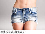 Купить «Beautiful woman body in denim jeans shorts on white background», фото № 28536039, снято 12 января 2016 г. (c) Ingram Publishing / Фотобанк Лори