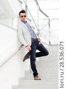Купить «Portrait of a young handsome man, model of fashion, wearing tinted sunglasses», фото № 28536071, снято 25 апреля 2012 г. (c) Ingram Publishing / Фотобанк Лори