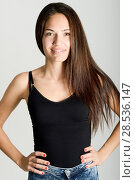 Beautiful young woman without make-up smiling. Beautiful girl with green eyes, model of fashion wearing black tank top on white background. Стоковое фото, фотограф Javier Sánchez Mingorance / Ingram Publishing / Фотобанк Лори