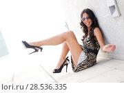 Купить «Funny female model at fashion with high heels sitting on the floor», фото № 28536335, снято 9 октября 2011 г. (c) Ingram Publishing / Фотобанк Лори