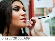 Professional makeup with a beautiful young woman having touches applied to her make up by a beautician. Стоковое фото, фотограф Javier Sánchez Mingorance / Ingram Publishing / Фотобанк Лори
