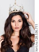 Купить «Crowned woman like miss of beauty looking at camera isolated on white background. Girl wearing crown, studio shot.», фото № 28536711, снято 30 мая 2017 г. (c) Ingram Publishing / Фотобанк Лори